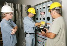 electricians-working-on-an-industrial-power-distribution-center.jpg